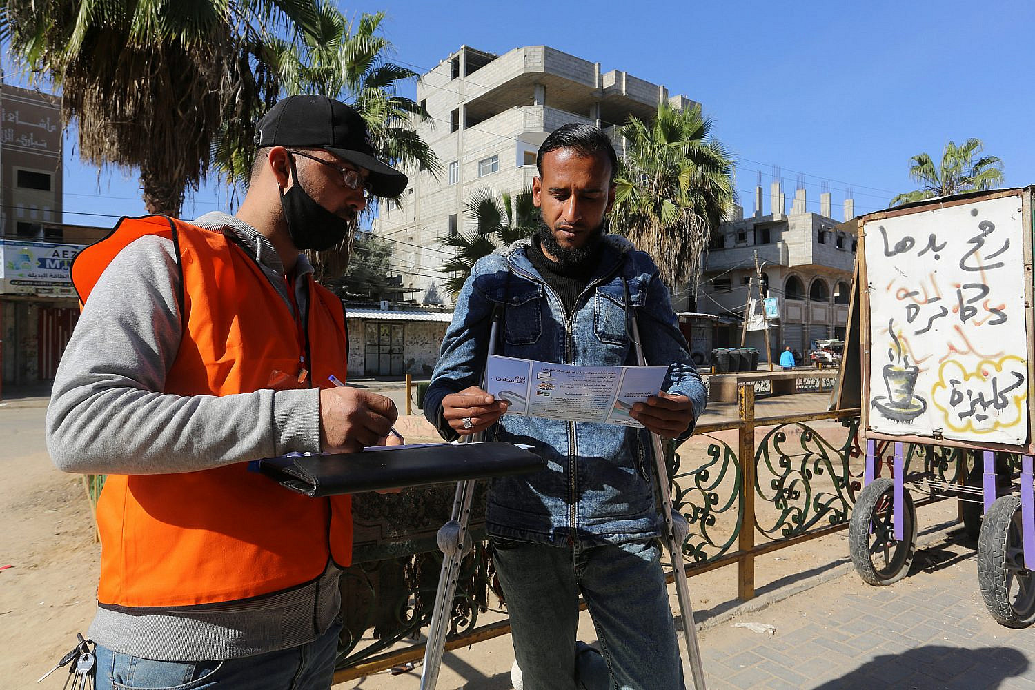 Palestinian Central Election Commission workers register residents in preparation for May elections, in Rafah, southern Gaza Strip, Feb. 10, 2021. (Abed Rahim Khatib/Flash90 )