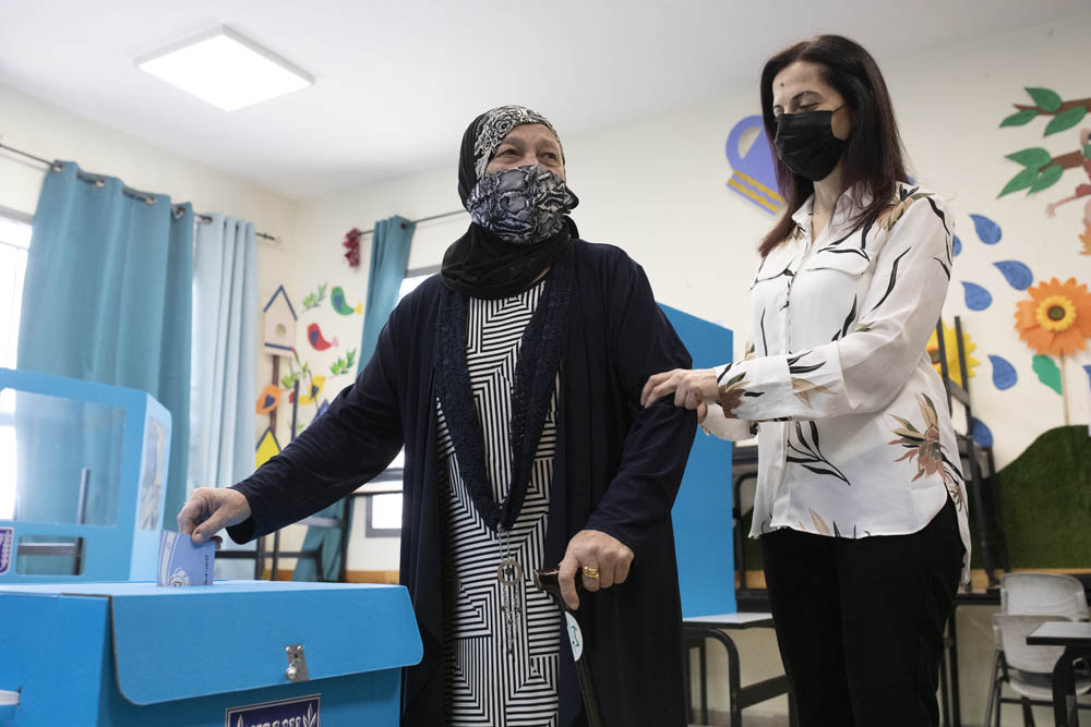 Palestinian women vote in Israel's 2021 election at a polling station, Taybeh, northern Israel, March 23, 2021. (Oren Ziv)