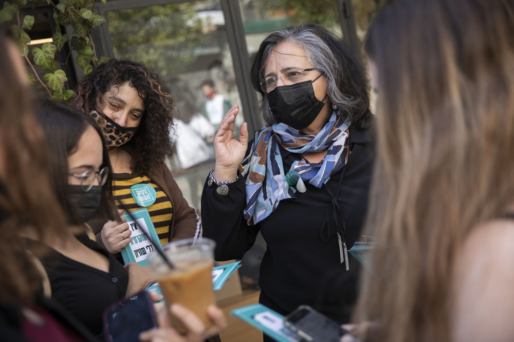 Joint List MK Aida Touma-Suleiman campaigns in Tel Aviv ahead of the Israeli elections, February 24, 2021. (Oren Ziv)
