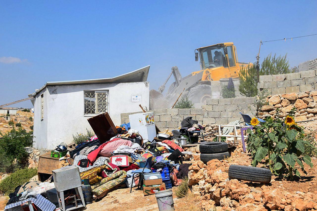 Israeli authorities demolish a house in the hamlet of Khalat al-Daba, in the occupied West Bank, June 17, 2019. (Wissam Hashlamon/Flash90)
