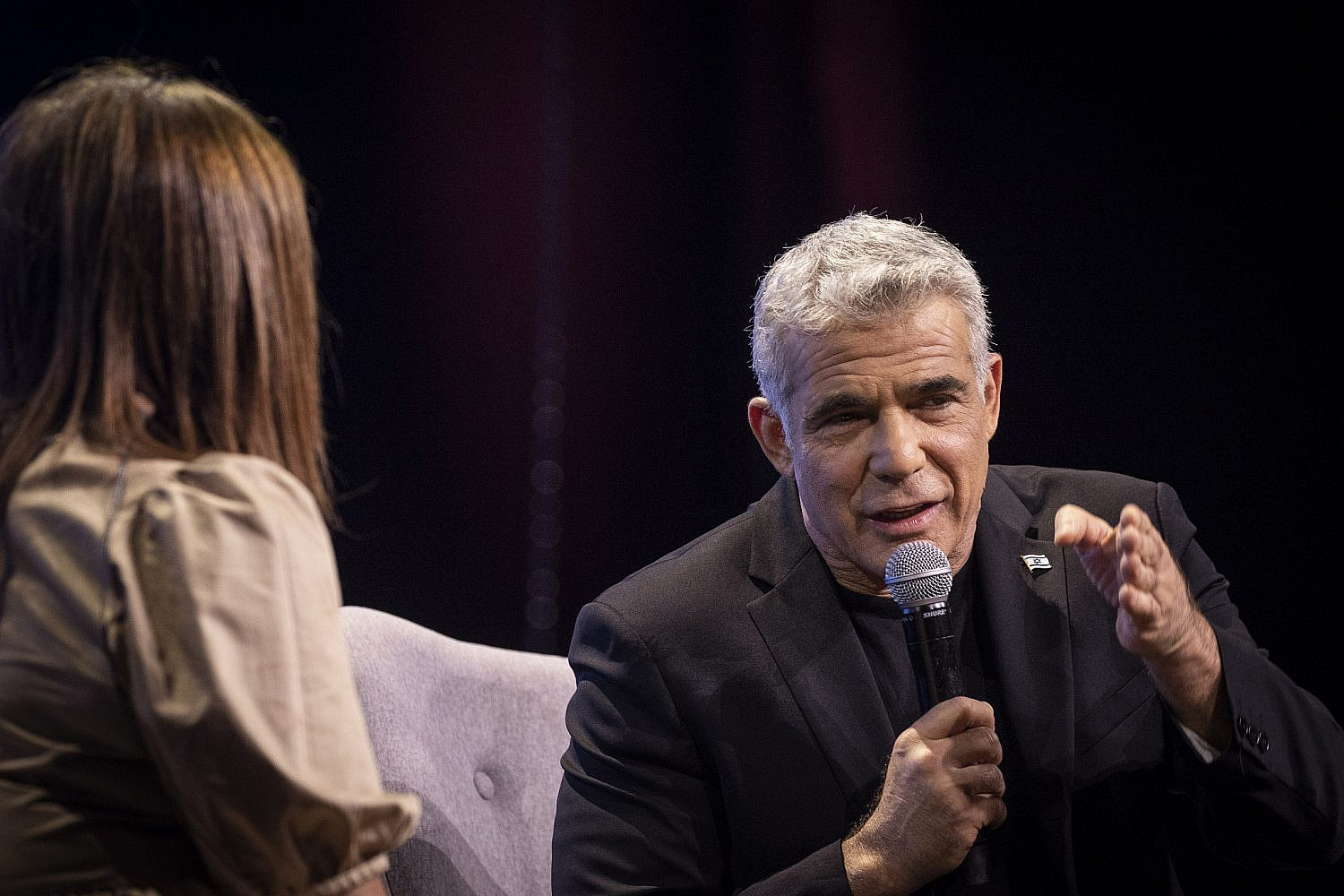 Yesh Atid leader Yair Lapid speaks with Channel 12 News anchor Rina Mazliah during the conference of the Israeli Television News Company in Tel Aviv, Sept. 5, 2019. (Hadas Parush/Flash90)