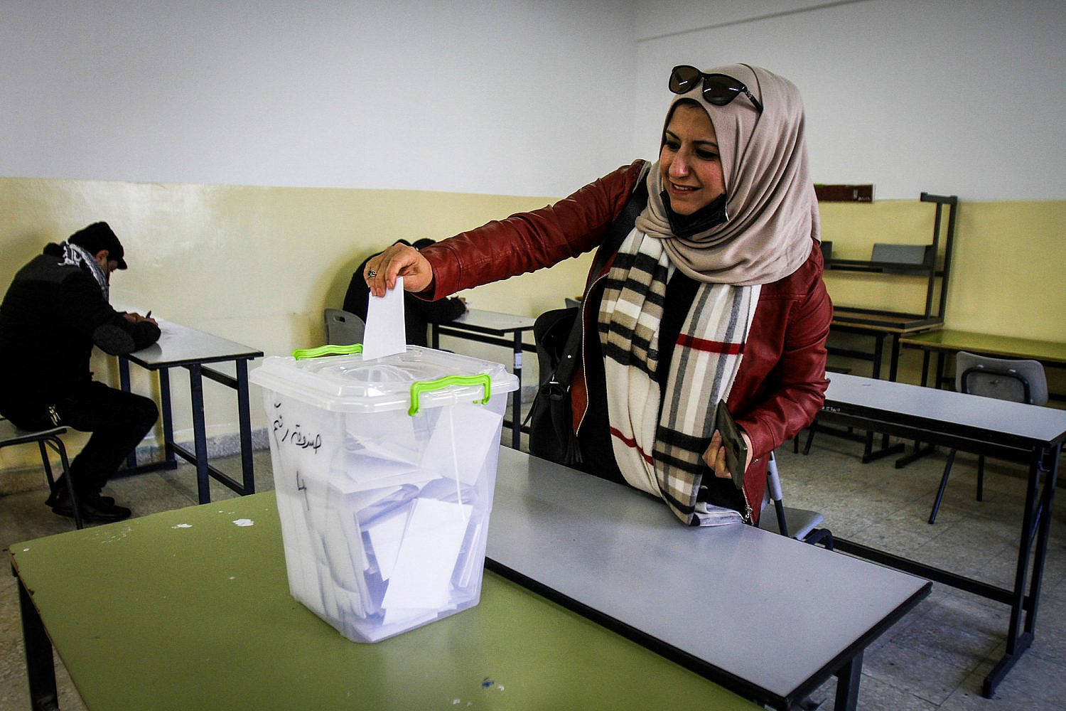 A Palestinian woman casts her ballot during the elections for the Fatah movement, on the outskirts of the West Bank city of Nablus, Jan. 23, 2021. (Nasser Ishtayeh/Flash90)