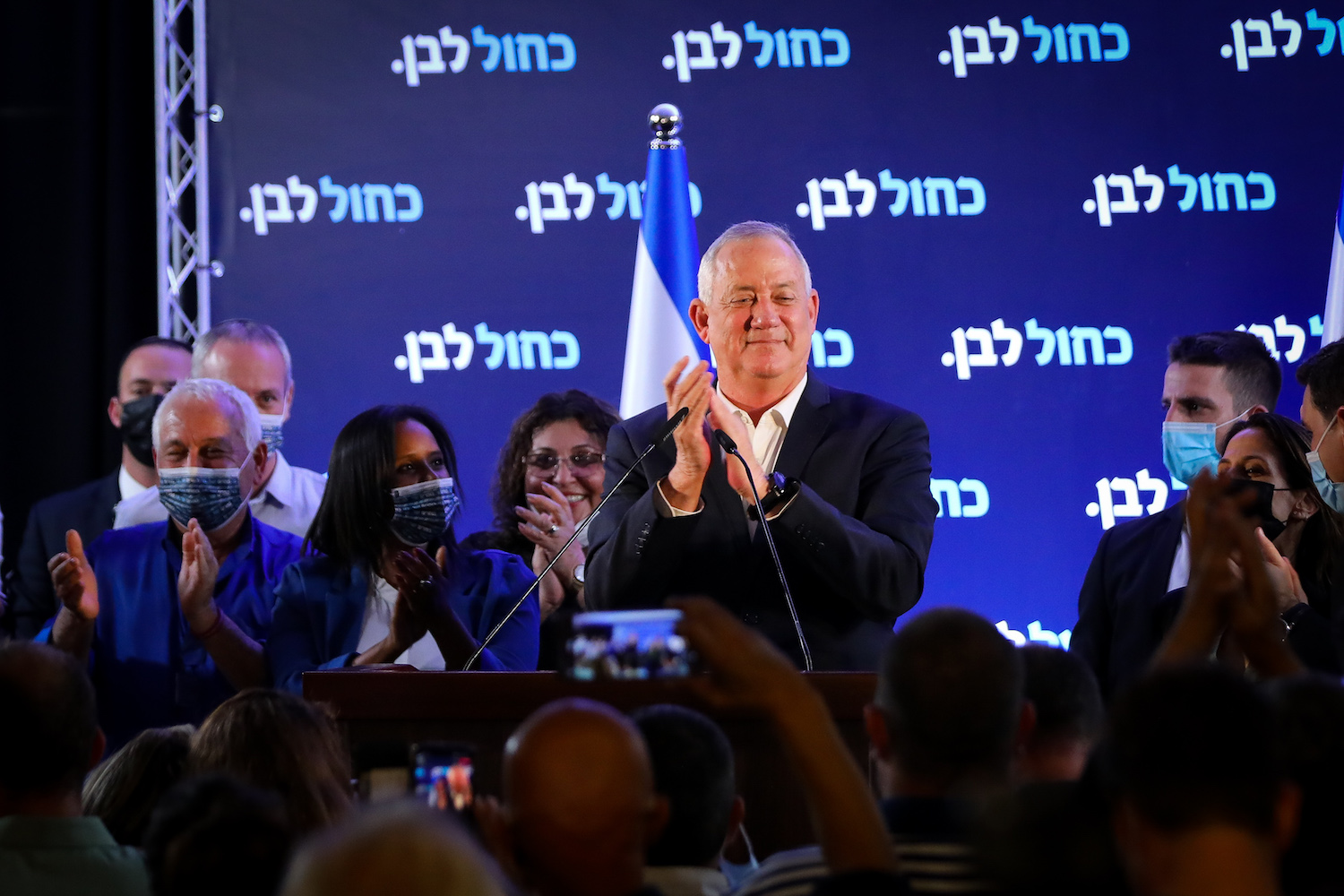 Head of Blue and White Party and Defense Benny Gantz speaks to supporters at his party's headquarters in Ramat Gan on elections night, March 23, 2021. (Flash90)