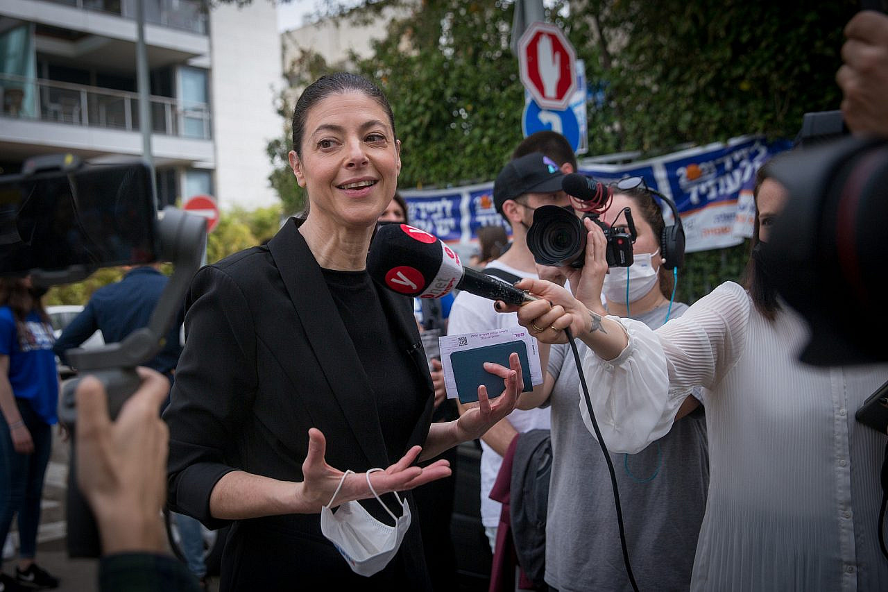 Head of the Labour party Merav Michaeli speaks to press as she arrives to cast her ballot at a voting station in Tel Aviv, during the Knesset elections, March 23, 2021. (Miriam Alster/Flash90)