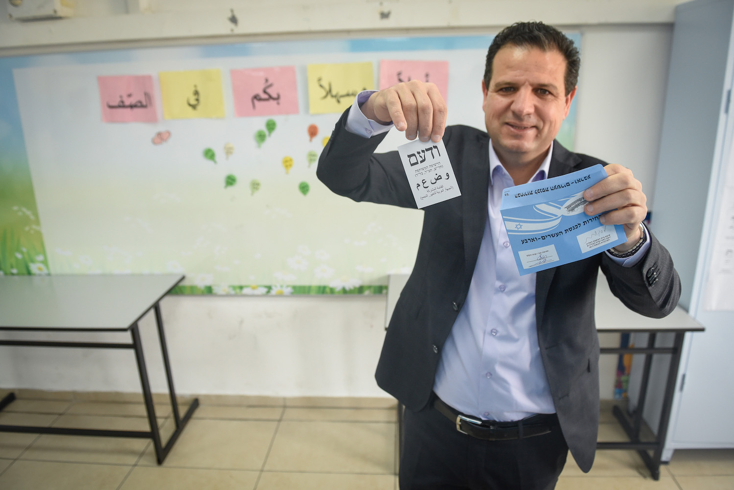 Joint List party leader Ayman Odeh casts his ballot at a voting station in Haifa, March 23, 2021. (Roni Ofer/Flash90)
