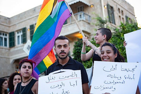 LGBTQ Palestinians take part in a protest following the stabbing of a queer Arab teen in Tel Aviv, August 1, 2019. (Mati Milstein)