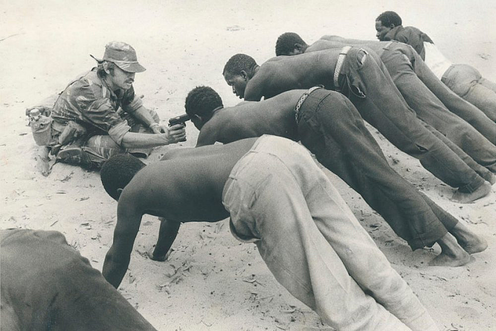 A Rhodesian soldier questioning villagers near the border of Botswana in the fall of 1977. (J. Ross Baughman)