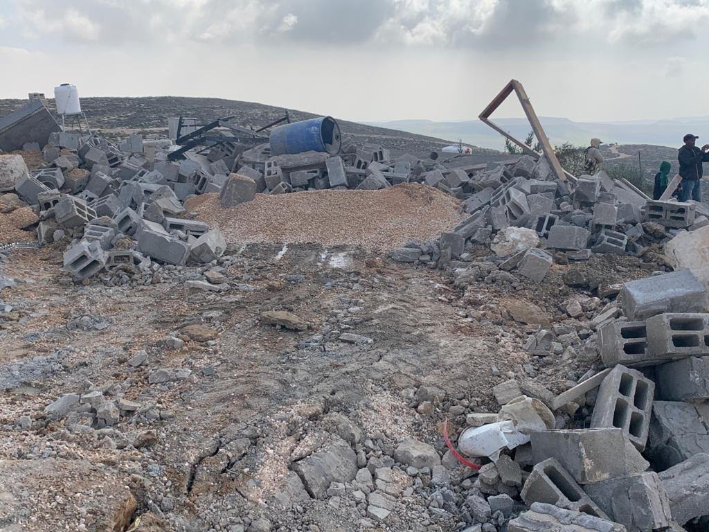 Israeli forces demolishing structures in the hamlet of Khalet al-Daba, in the occupied West Bank, March 2, 2021. (Basil al-Adraa)