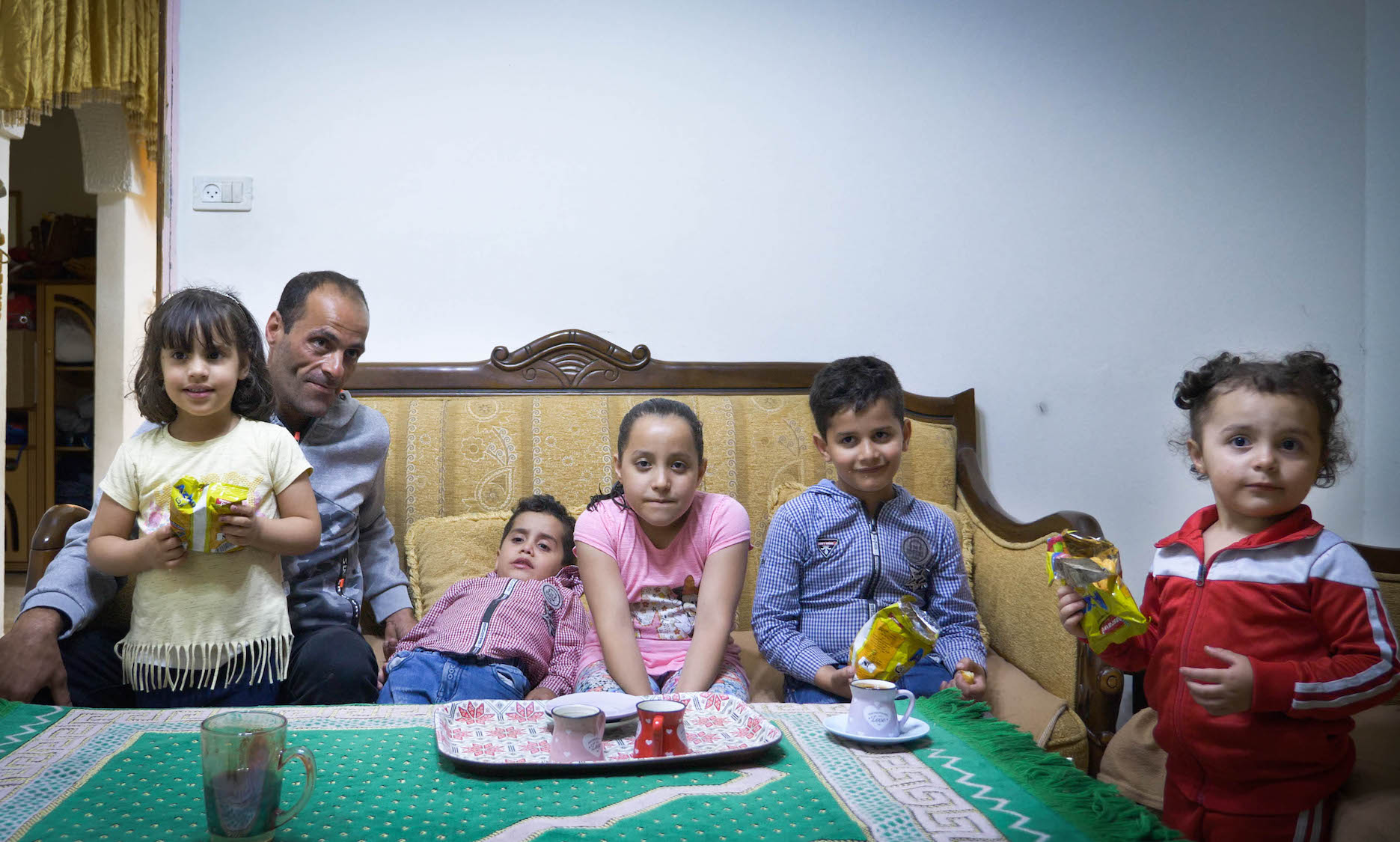 Ahmad Abu Diab and his children in their home in Silwan, East Jerusalem. (Rachel Shor)