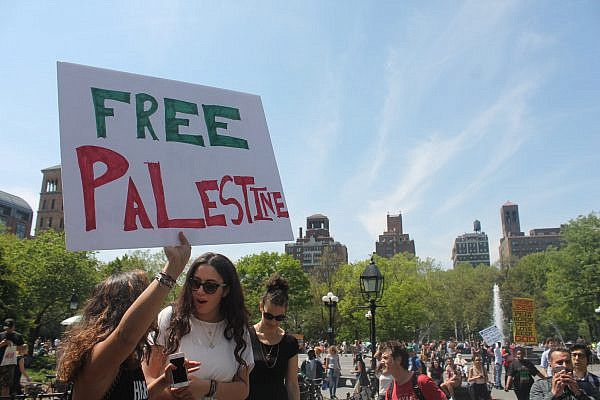 Members and supporters of NYU Students for Justice in Palestine rally in Washington Square Park to commemorate the 68th anniversary of the Nakba, adjacent to a gathering by the pro-Israel group CAMERA on Campus. May 12, 2016. (Joe Catron/(CC BY-NC 2.0)