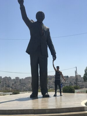 The Instagram photo of Ahmad Daraldik at the Nelson Mandela statue in Ramallah, whose caption sparked a wave of harassment against him. (Ahmad Daraldik)