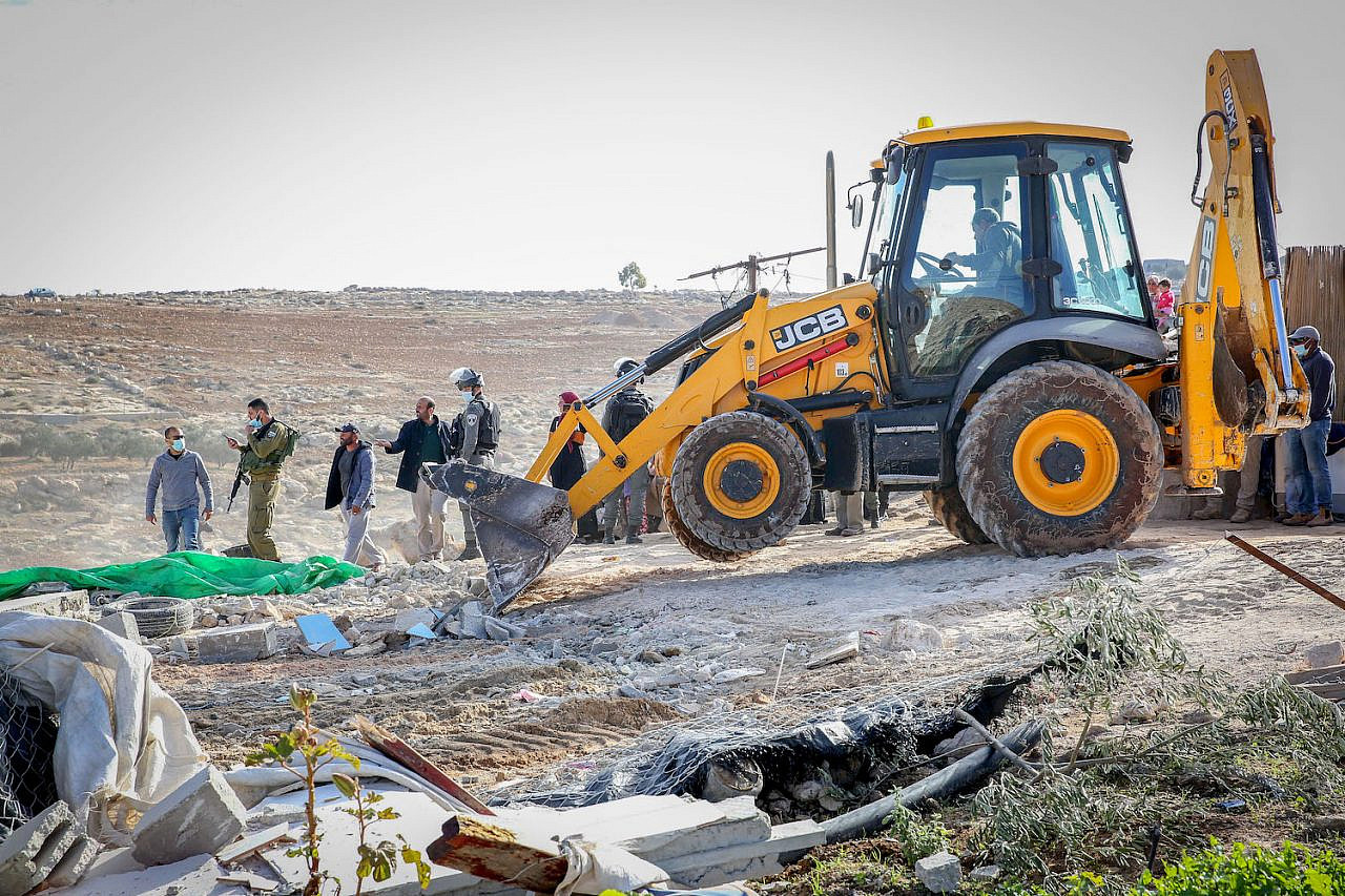 Israeli authorities demolish a tent in the West Bank area of Masafer, near the city of Yatta in south Hebron, on November 25, 2020. (Wissam Hashlamon/Flash90)