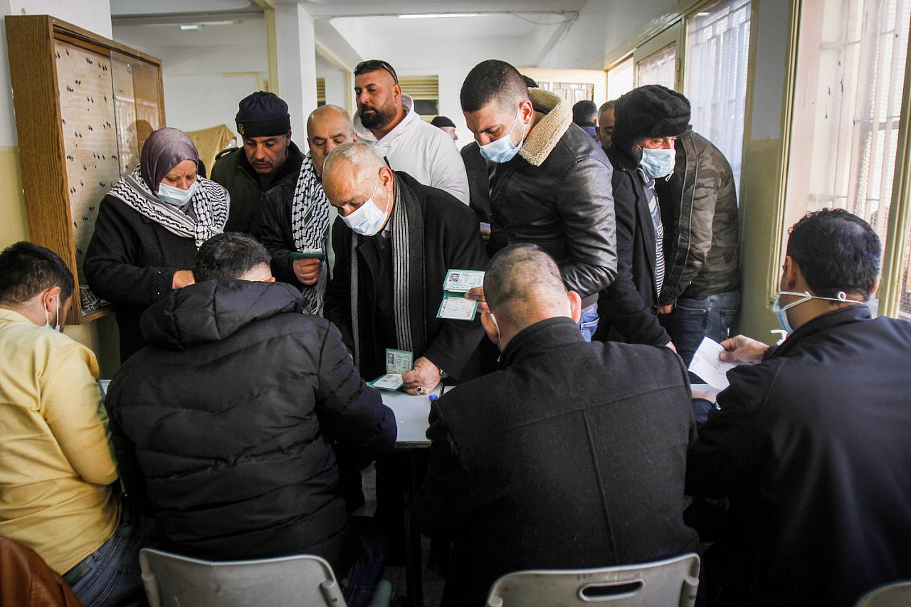 Palestinians arrive to cast their ballot during elections for the Fatah movement near the West Bank city of Nablus, January 23, 2021. (Nasser Ishtayeh/Flash90)