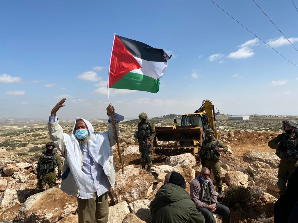 Hajj Suleiman from Umm al-Kheir, one of the West Bank villages that grazes in the area of Ein al-Beida, protests Israeli settlement development, March 8, 2021. (Natasha Westheimer)