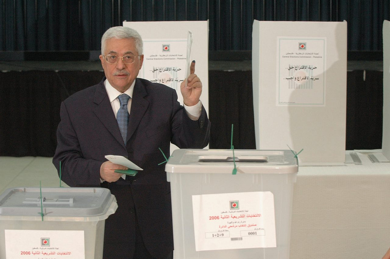In the West Bank town of Ramallah, Palestinian President Mahmoud Abbas casts his vote in the Palestinian parliamentary elections on January 25, 2006. (Yossi Zamir/Flash90)
