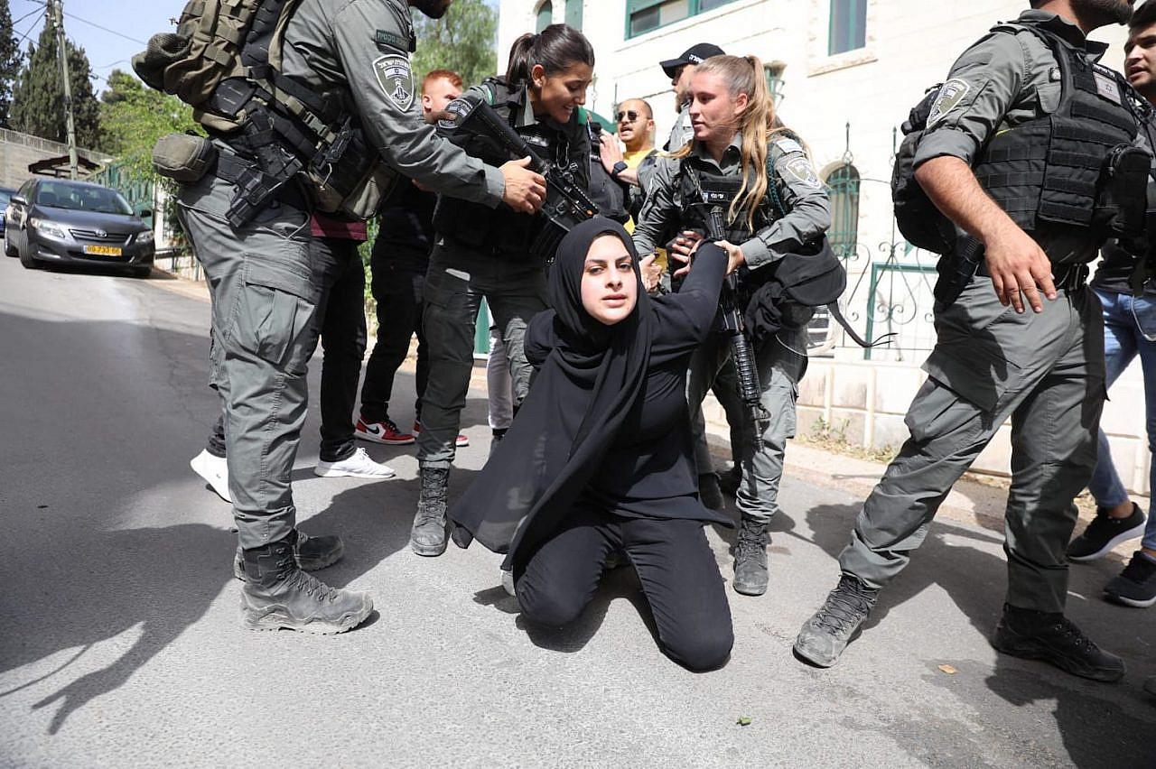 Israeli police detain a Palestinian woman in Sheikh Jarrah, May 10, 2021. (Oren Ziv)