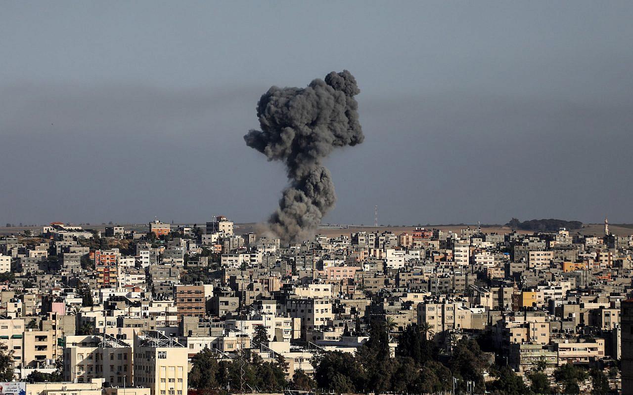 Smoke rises after an Israeli airstrike in Gaza City, May 11, 2021. (Mohammed Zaanoun/Activestills)