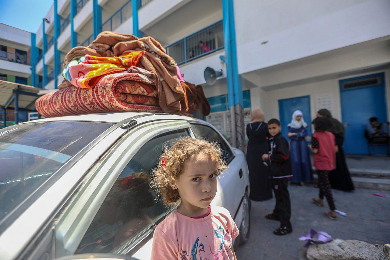 According to the UN, 10,000 Palestinians were displaced from the northern Gaza Strip following Israeli airstrikes, forcing them to take shelter at an UNRWA schools in Gaza City, May 14. 2021. (Mohammed Zaanoun/Activestills)