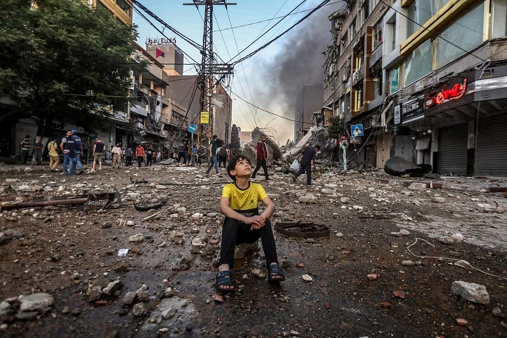 A Palestinian child seen in the wreckage of a neighborhood in Gaza following an Israeli airstrike, May 12, 2012. (Mohammed Zaanoun)