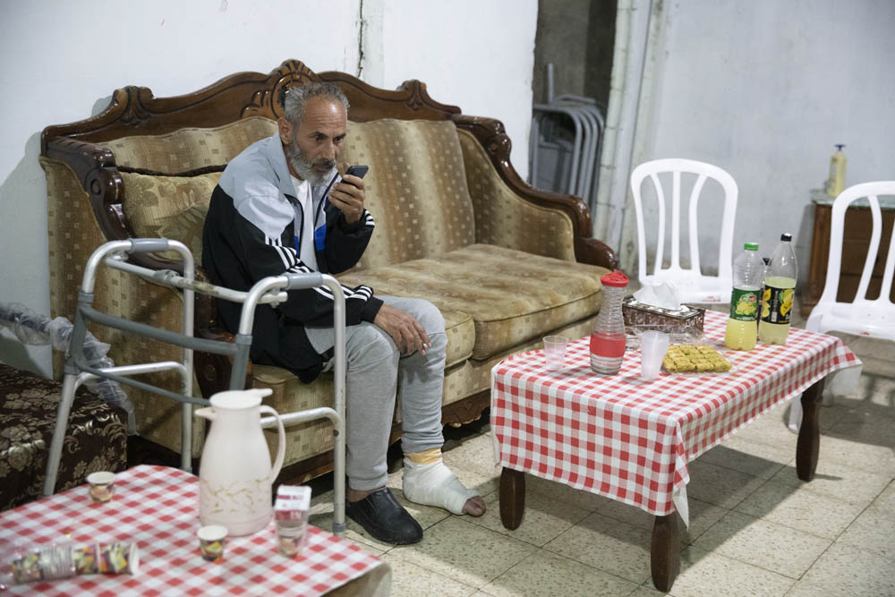 Salah Diab, one of the leaders of the Sheikh Jarrah protest movement, seen in his home. 'The police are acting foolishly, its violence begets more violence. People are merely gathering for a vigil, and they are attacked.' May 4, 2021. (Oren Ziv)