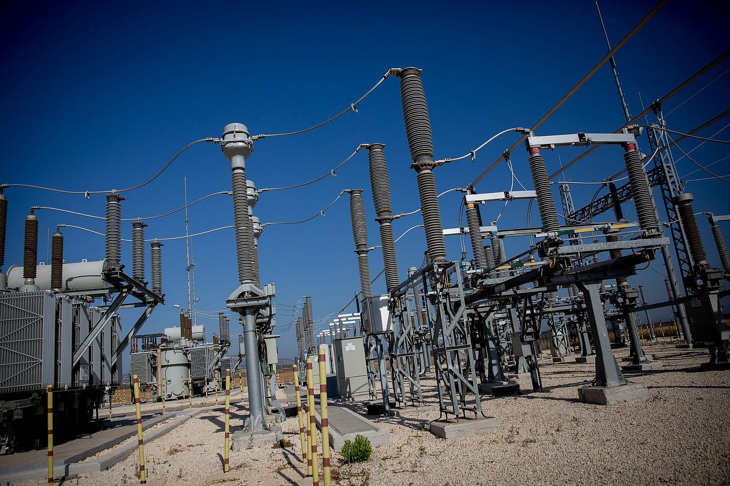 The opening of a first completely Palestinian-owned and managed electricity substation, outside of Jenin, West Bank. The station was built by Israel Electric Corporation, but owned by the Palestinian Electric Authority (PEA) and the PA. July 10, 2017. (Miriam Alster/Flash90)