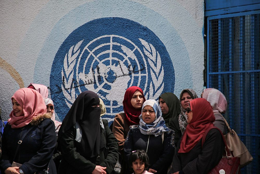UNRWA staff members protest against budget cuts outside the UNRWA offices in Gaza City, April 14, 2019. (Hassan Jedi/Flash90)