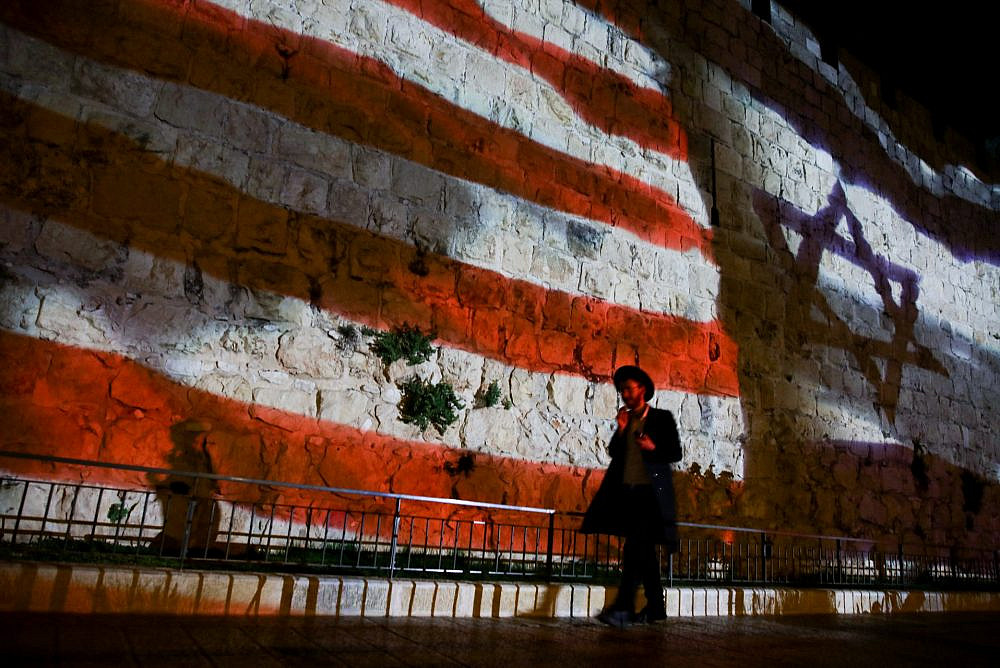 The Israeli and American flags screened on the walls of Jerusalem's Old City to mark one year since the transfer of the US Embassy from Tel Aviv to Jerusalem, May 14, 2019. (Aharon Krohn/Flash90)