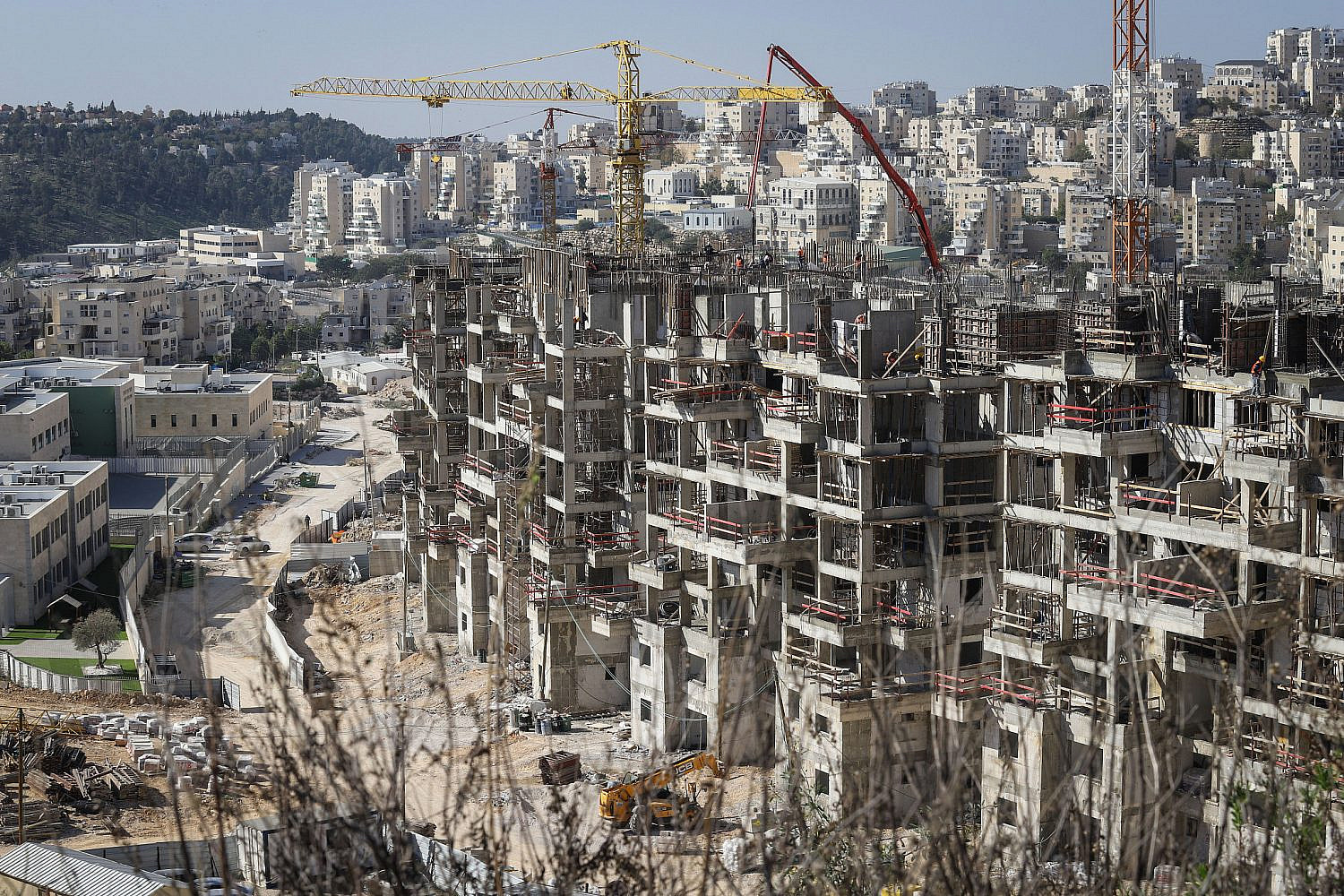 Construction work for new housing in the ultra Orthodox settlement of Modi'in Illit. Jan. 11, 2021. (Flash90)