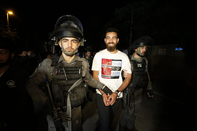 Israeli security forces arrest protesters during a demonstration against Israel's plan to evict Palestinians in the East Jerusalem neighborhood of Sheikh Jarrah, Jerusalem, May 6, 2021. (Jamal Awad/Flash90)