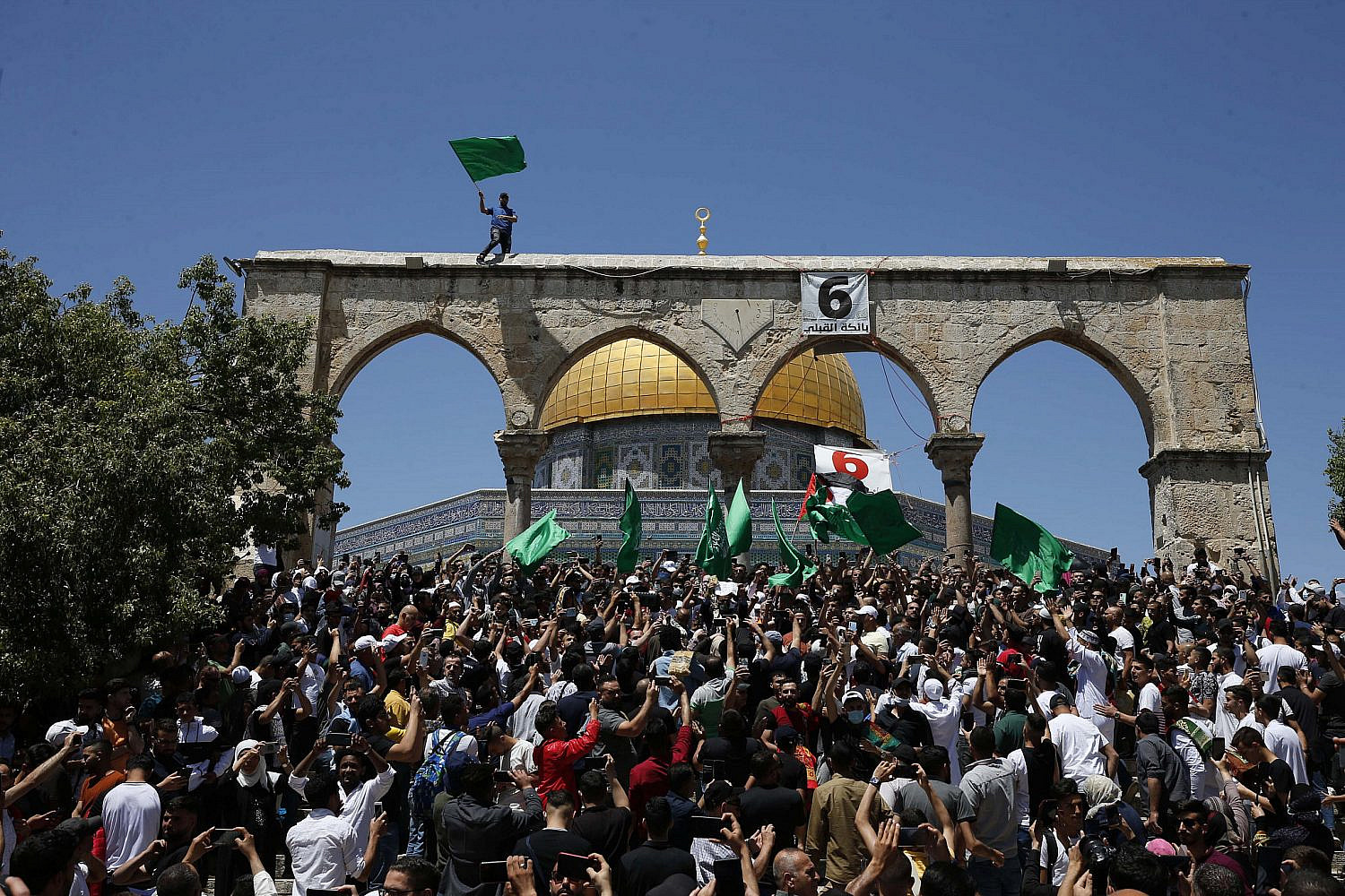 Palestinians gather in front of the Dome of the Rock after performing the last Friday prayer of Ramadan to protest over the eviction of several Palestinian families from homes in the East Jerusalem neighborhood of Sheikh Jarrah, Jerusalem, May 7, 2021. (Jamal Awad/Flash90)