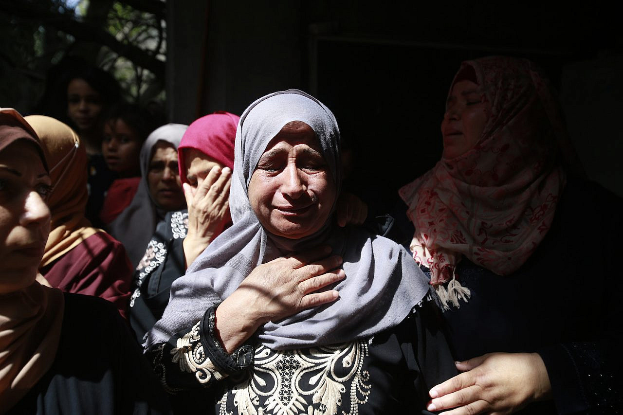 Palestinians mourn the killing of 11-year-old Hussain Hamad, who was killed in an Israeli air strike in Beit Hanoun, northern Gaza Strip, May 11, 2021. (Atia Mohammed/Flash90)