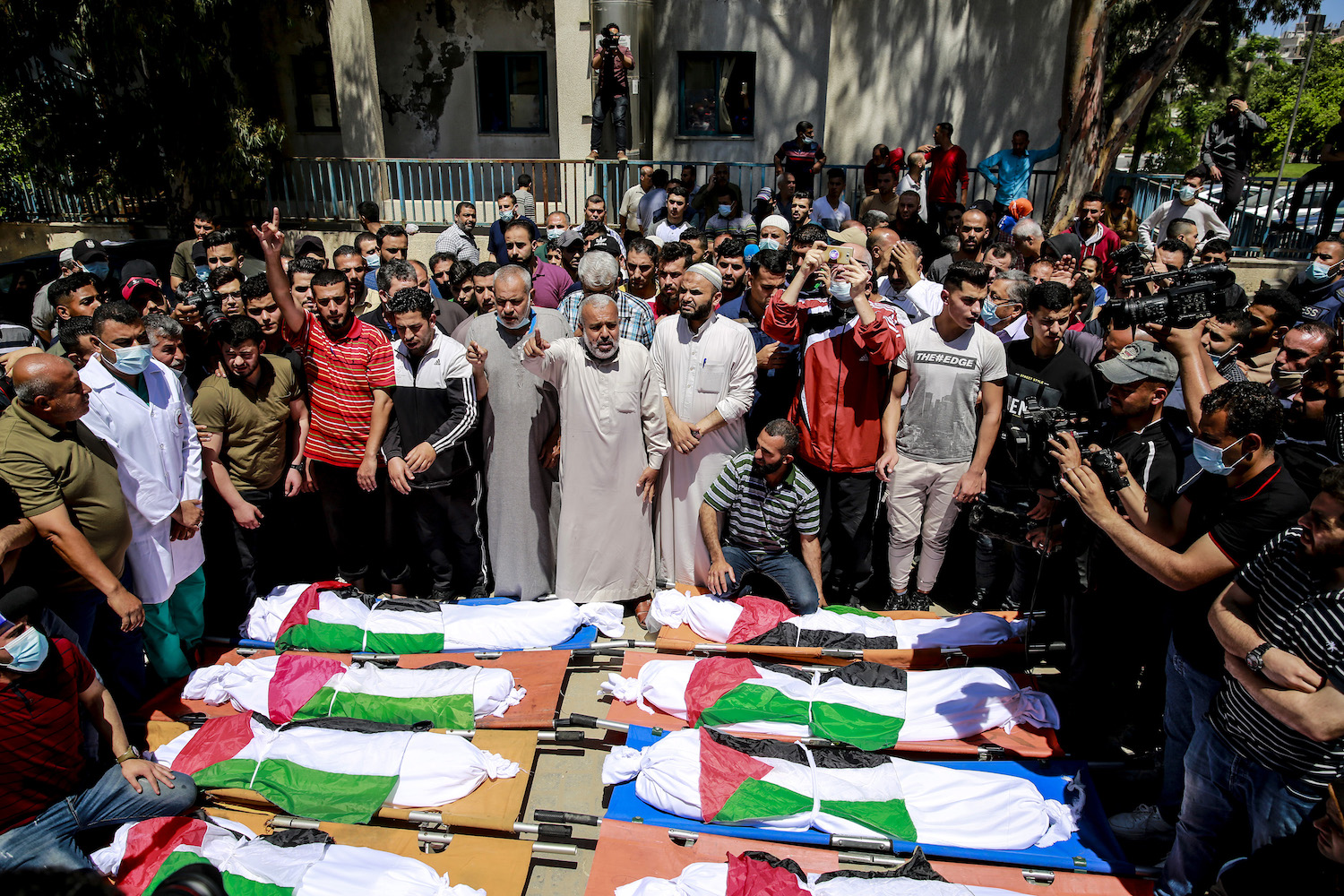 Palestinians attend the funeral of 10 members of Abu-Hatab family, who were killed by an Israeli air strike in Al-Shati Refugee Camp in Gaza City, May 15, 2021. (Atia Mohammed/Flash90)