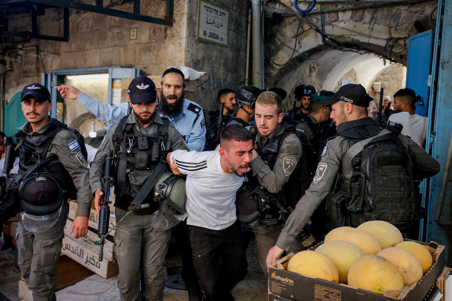 Israeli police officers arrest a Palestinian man during protests in Jerusalem's Old City, May 18, 2021. (Jamal Awad/Flash90)