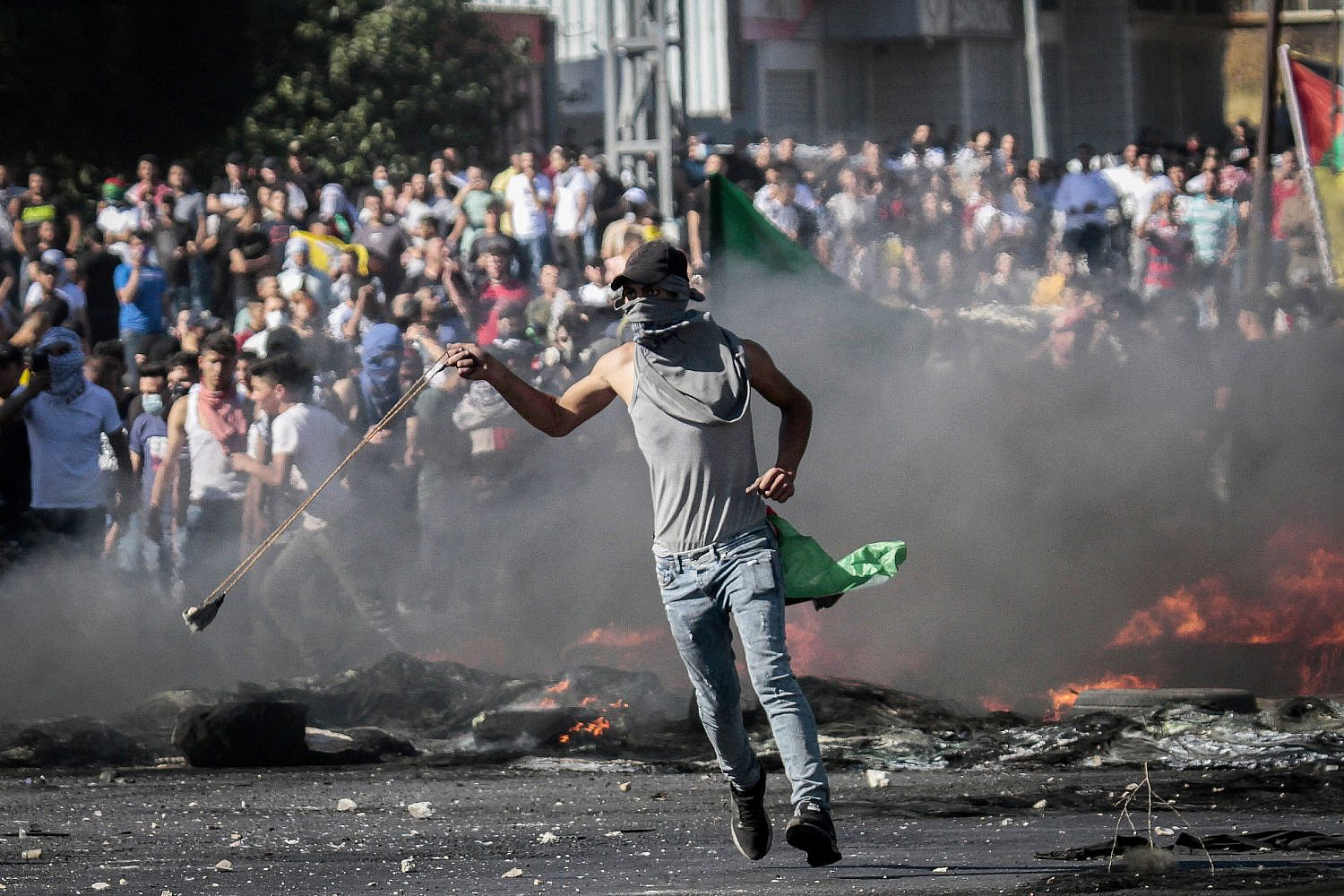 Palestinian protesters clash with Israeli security forces near the Hawara checkpoint, south of the West Bank city of Nablus, May 18, 2021. (Nasser Ishtayeh/Flash90)