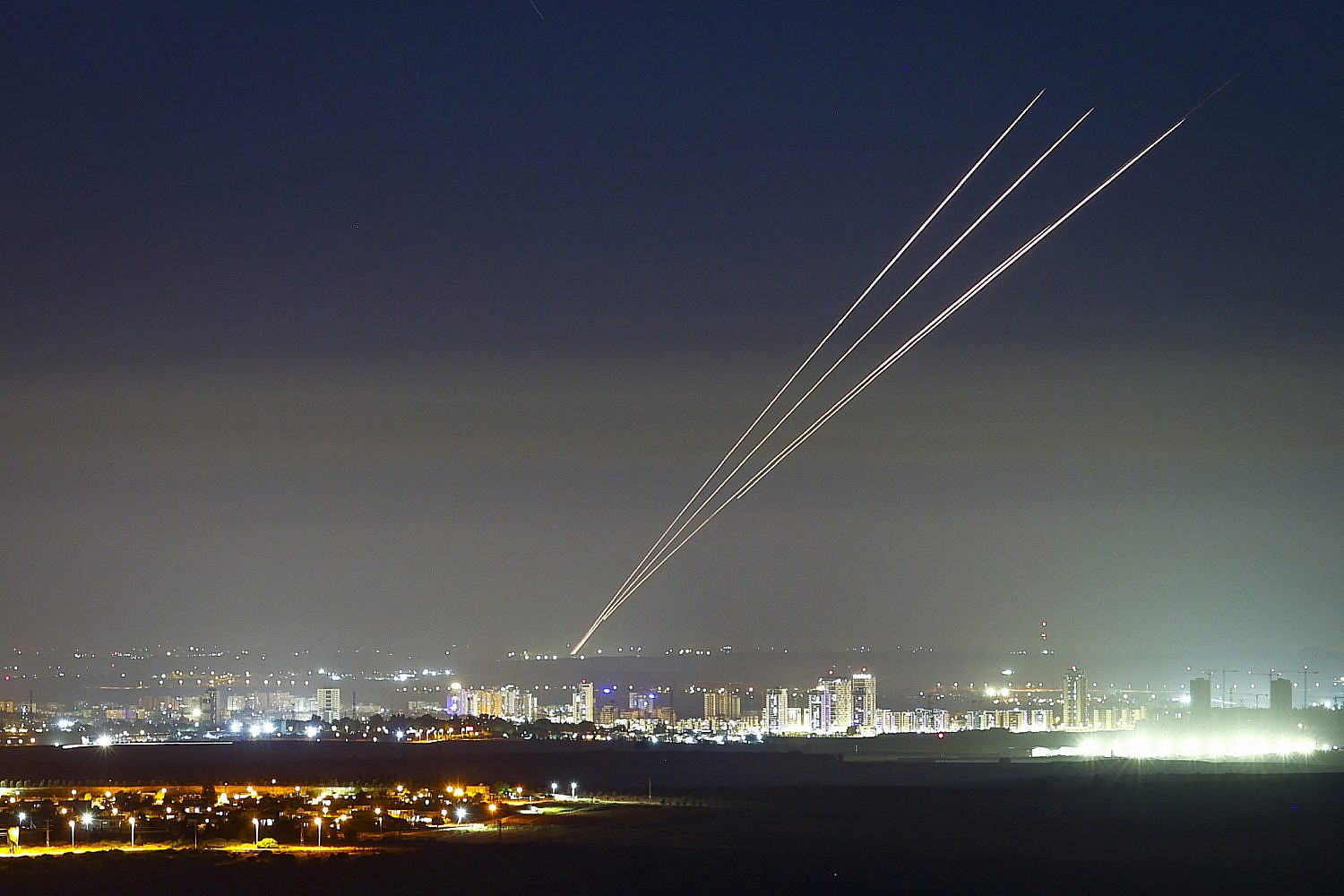 Rockets fired by Hamas militants in Gaza into Israel, seen over the central Israeli town of Kiryat Gat, May 18, 2021. (Nati Shohat/Flash90)