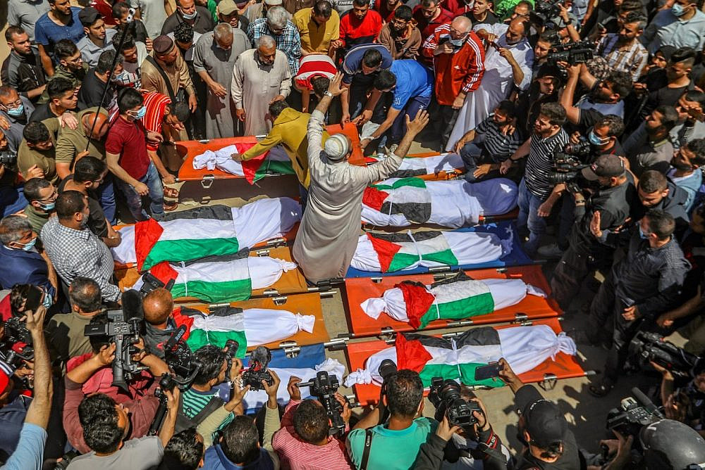 Hundreds of Palestinians attend a funeral for the Abu Hatab family in Gaza City, on May 15, 2021. Eight children and two women belonging to the family were killed after their three-story building in Shati refugee camp collapsed following an Israeli strike, medical sources said. (Mohammed Zaanoun/Activestills)