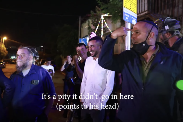 Jerusalem Deputy Mayor Aryeh King, flanked by settlers and Kahanist activists, mocks Palestinian activist Muhammad Abu Hummus during a visit to the East Jerusalem neighborhood of Sheikh Jarrah, May 6, 2021. (Screenshot)