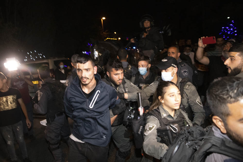 Israeli police arrest Mahmoud El-Kurd, a resident of Sheikh Jarrah, during a vigil against the upcoming eviction of Palestinian families from the neighborhood, May 4, 2021. (Oren Ziv)