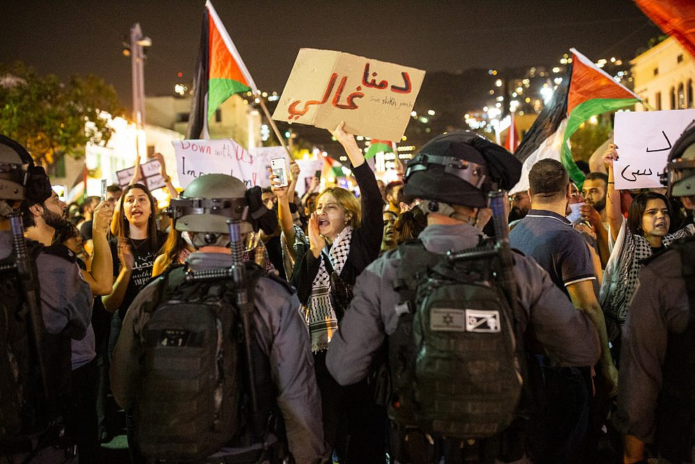 Palestinian citizens of Israel confront Israeli police officers during a demonstration in solidarity with Gaza and Jerusalem, downtown Haifa, May 9, 2021. (Mati Milstein)
