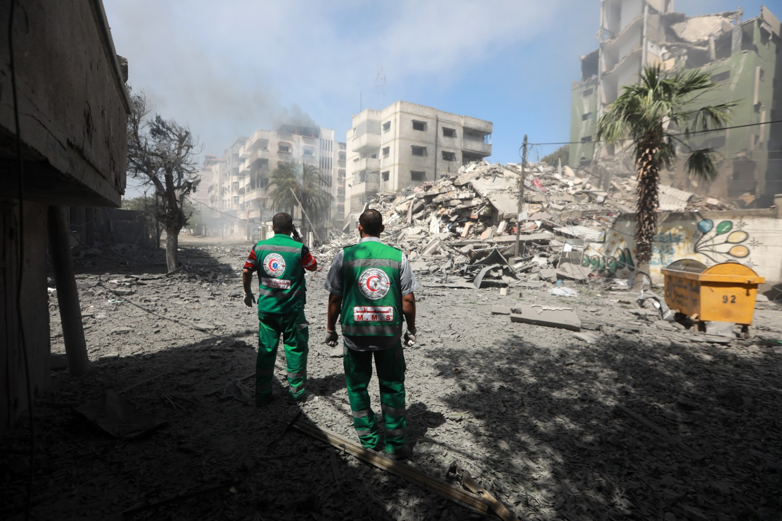 Medics with the Palestinian Red Crescent assessing damage after an Israeli airstrike in Gaza, May 7, 2021. (Mohammed Zaanoun/Activestills)