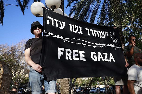 Israeli left-wing activists demonstrate in solidarity with Palestinians in Jaffa during the cross-country general strike to protest the war on Gaza and the upcoming eviction of several families from their homes in East Jerusalem, May 18, 2021. (Oren Ziv)