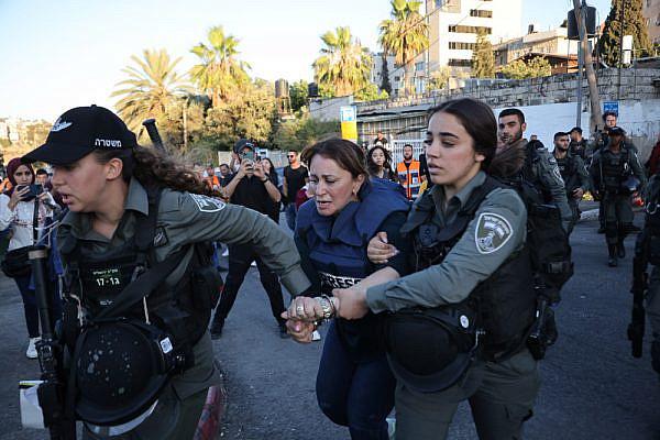 Israeli officers arrest Al Jazeera reporter Givara Budeiri in the East Jerusalem neighborhood of Sheikh Jarrah, June 6, 2021. (Oren Ziv)