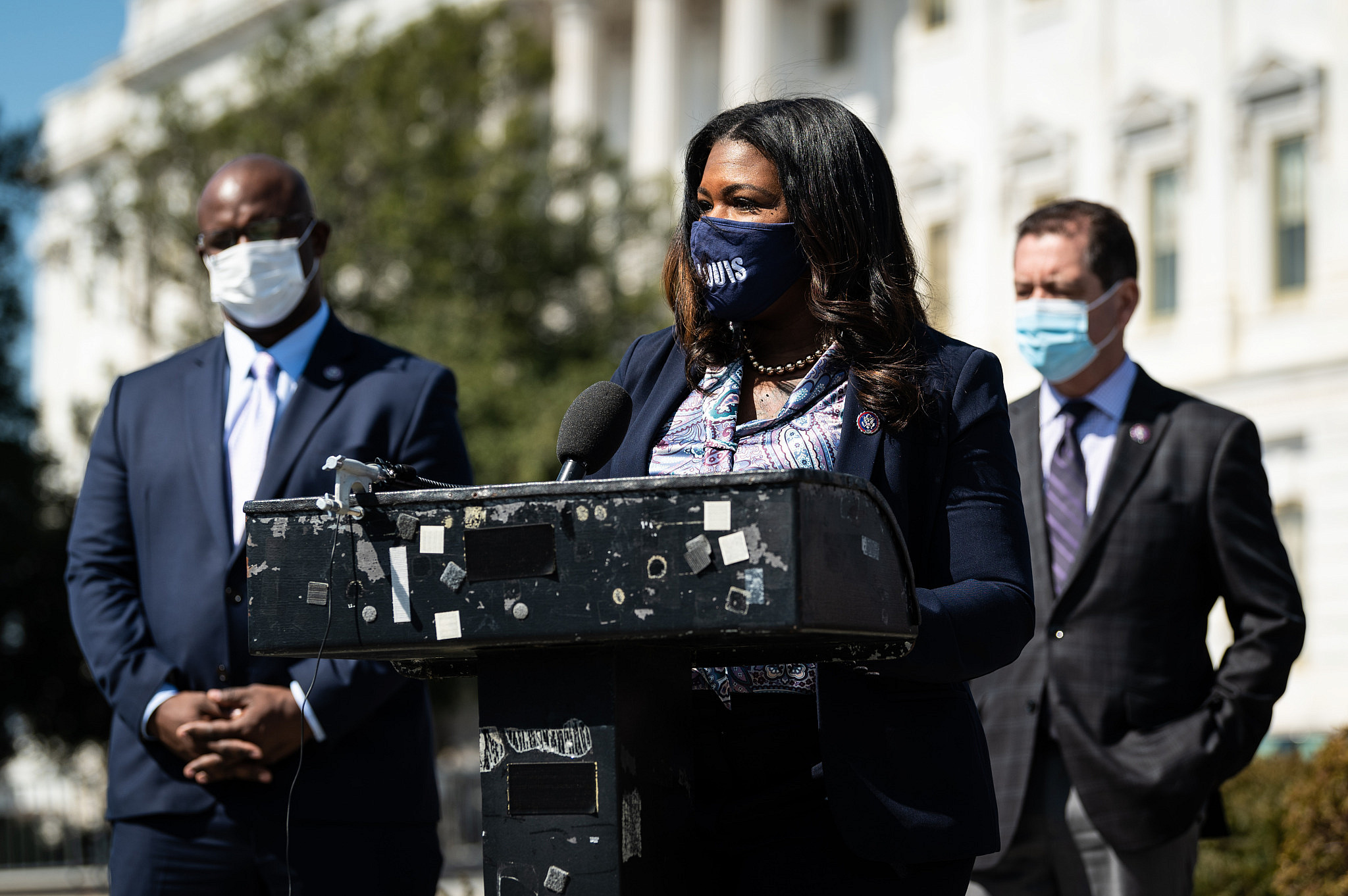 Congresswoman Cori Bush delivering a speech, with Rep. Jamaal Bowman in the background (Courtesy of Rep. Bush)