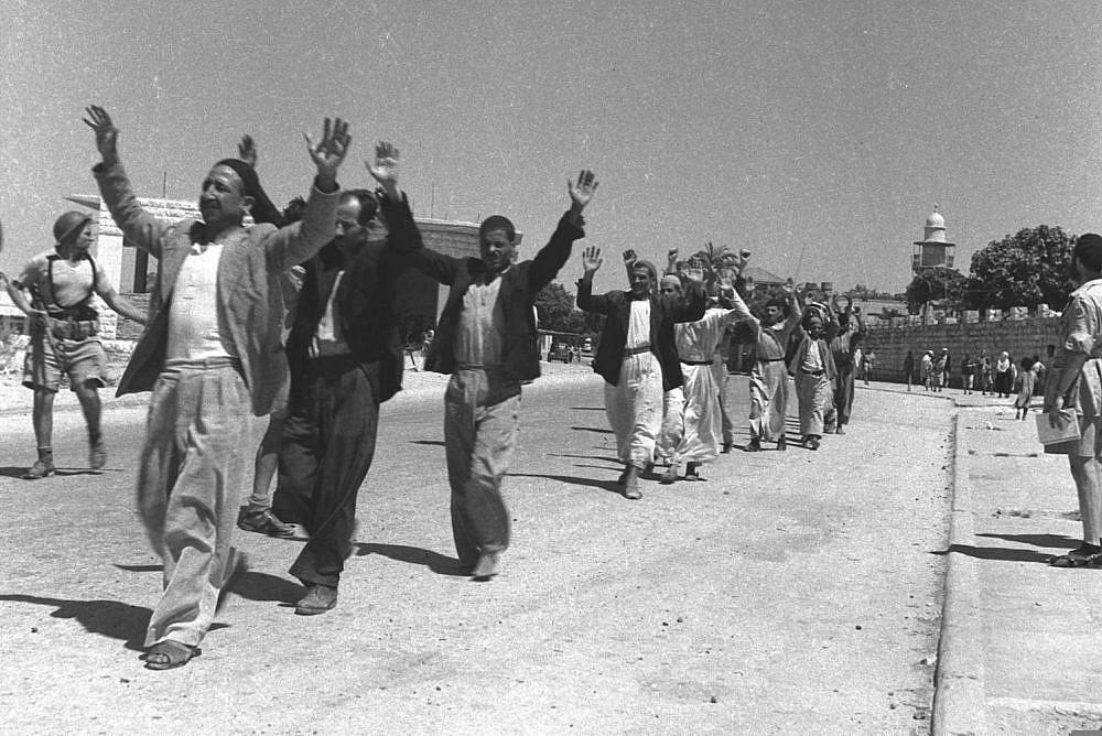 Palestinians surrender after Israeli troops capture the Palestinian city of Ramla during the 1948 war, July 11, 1948. (David Eldan)