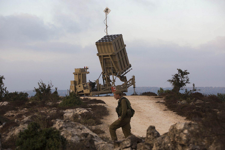 "Israeli soldier stands guard near an ""Iron Dome"" battery, a short-range missile defence system, near Jerusalem, Sept. 9, 2013. (Yonatan Sindel/Flash90)"