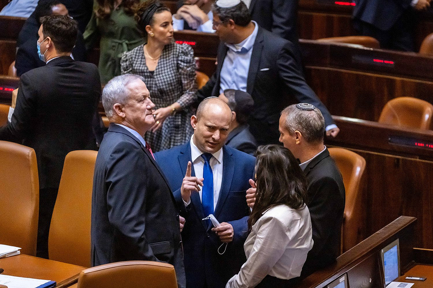 Head of the Yamina party Naftali Bennett, head of the Blue and White party Benny Gantz, Ayelet Shaked and Hilik Tropper seen in the plenum hall of the Israeli Knesset during the voting in the presidential elections, in Jerusalem, June 2, 2021. (Olivier Fitoussi/Flash90)