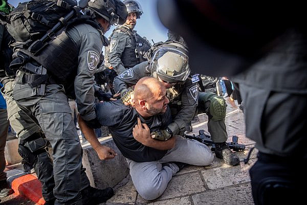 Israeli police officers during clashes with protesters following a visit of right-wing politician Itamar Ben Gvir at Damascus Gate in Jerusalem Old City, June 10, 2021. (Yonatan Sindel/Flash90)