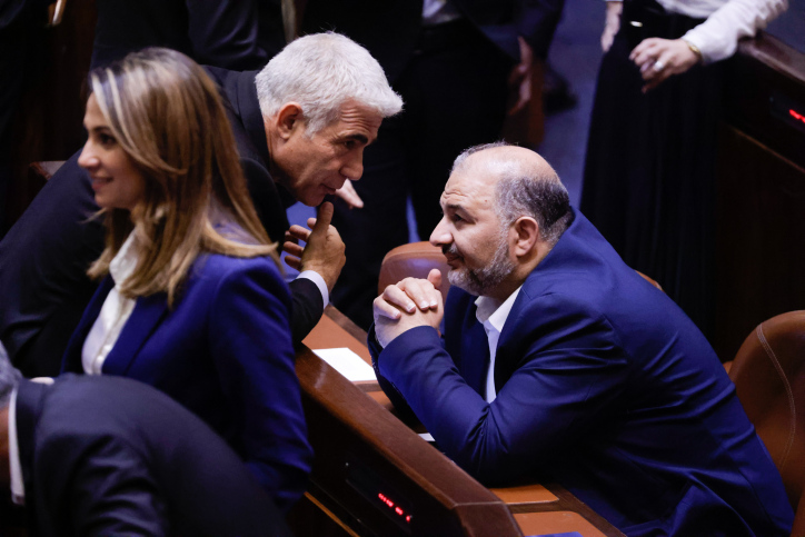 Israeli Foreign Minister Yair Lapid (left) with head of the Ra'am party Mansour Abbas in the Knesset, June 21, 2021. (Olivier Fitoussi/Flash90)