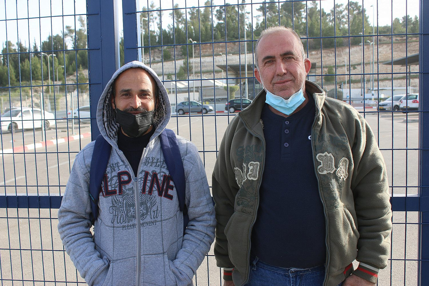 Ahmad Atawneh (r) and Haidar Atawneh (l), Palestinian workers from from the village of Beit Kahel, at the Tarqumiya checkpoint, the West Bank. (Activestills)
