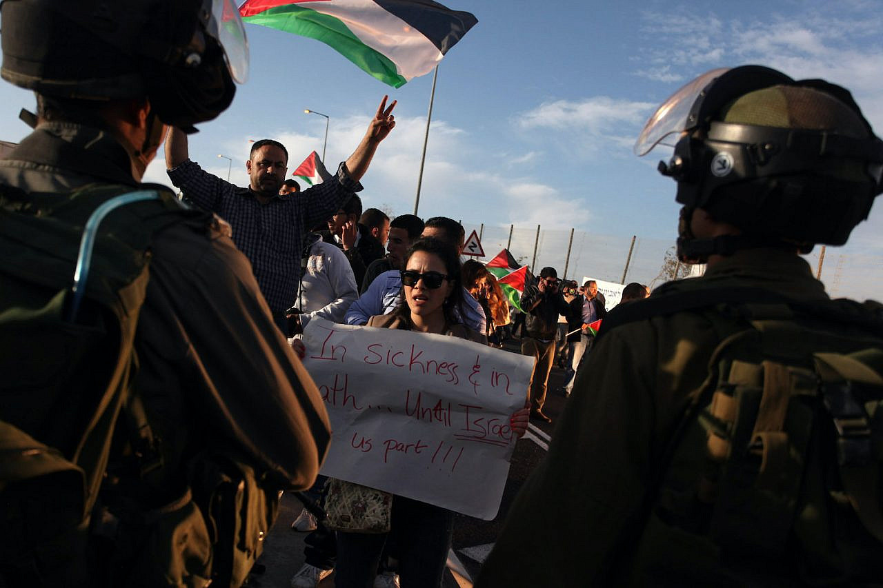 Israeli soldiers obstruct a symbolic wedding party in protest of the controversial Citizenship Law, near the Hizma in the occupied West Bank, between Jerusalem and and the Palestinian city of Ramallah, on March 9, 2013. (Issam Rimawi/Flash90)